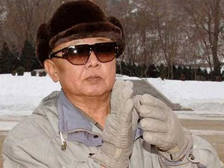 Kim Jong Il applauding with gloves while looking somewhat bored