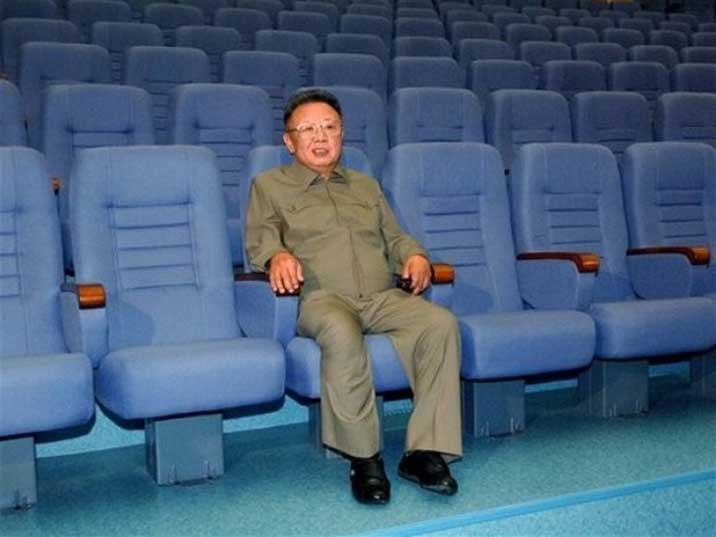 Kim Jong Il testing a seat in a renovated Pyongyang theatre