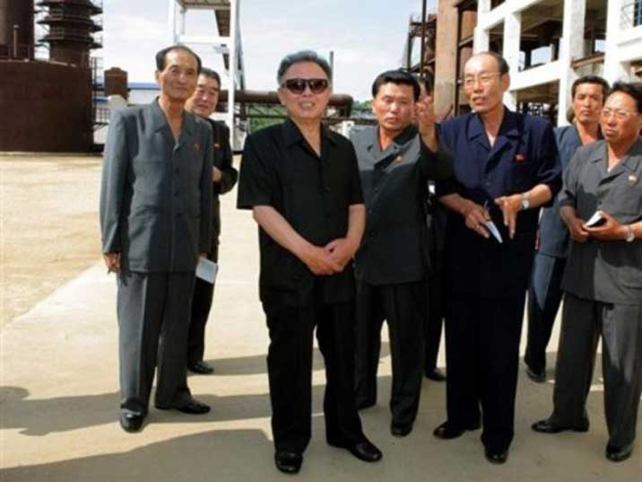 Kim Jong Il inspecting a factory, photo seems to be photo shopped