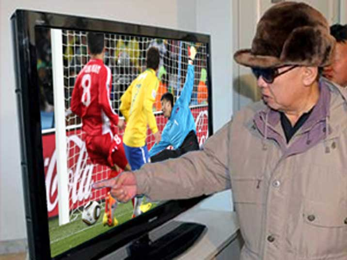 Kim Jong Il looking at a football match during the 2010 WC (PS)