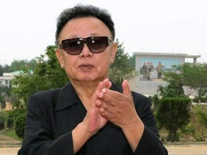 Kim Jong Il applauding for soldiers on a Korean People Army base