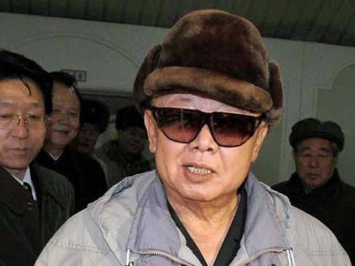 Kim Jong Il looks in the camera while he is Beijing watched