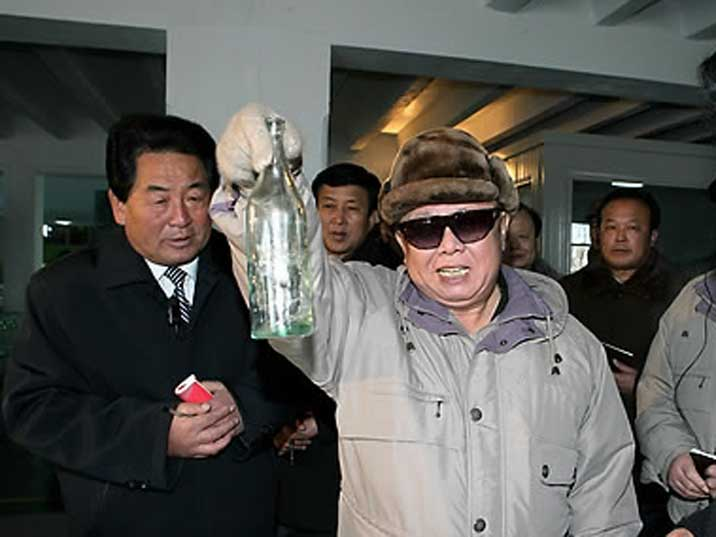Kim Jong Il inspects products at the Nampo Glass Bottle Factory