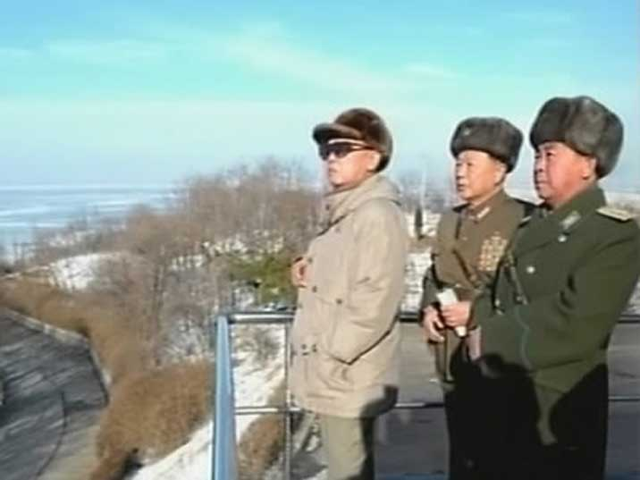 Kim Jong Il watching the KPA's joint military manoeuvres