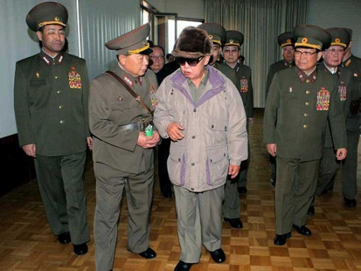 Kim Jong Il looking at his generals after a musical performance