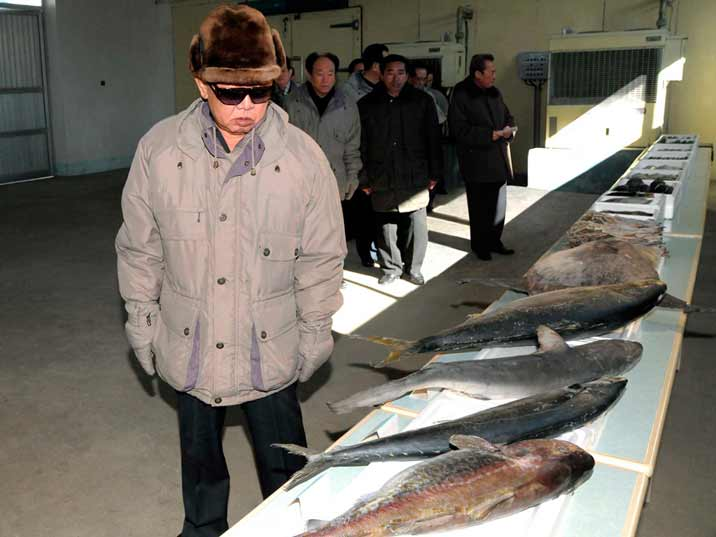 Kim Jong Il looking at fish in the Wonpyong Taehung Fishery Station in Kumya county