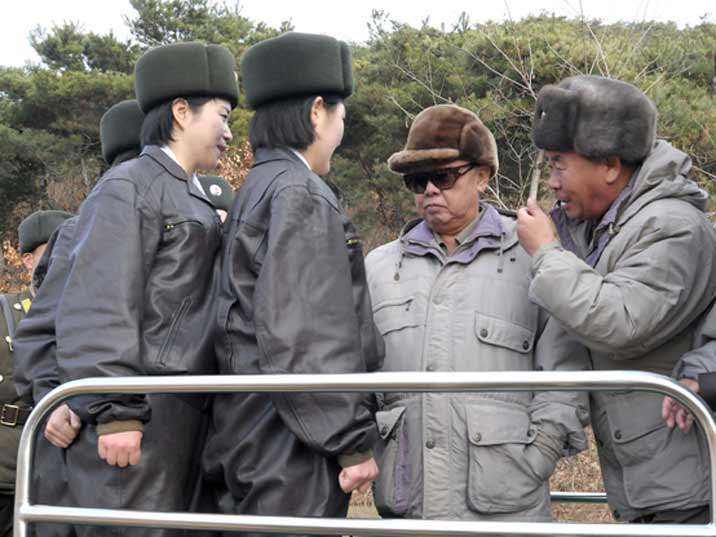 Kim Jong Il looking at female soldiers while visiting an army base