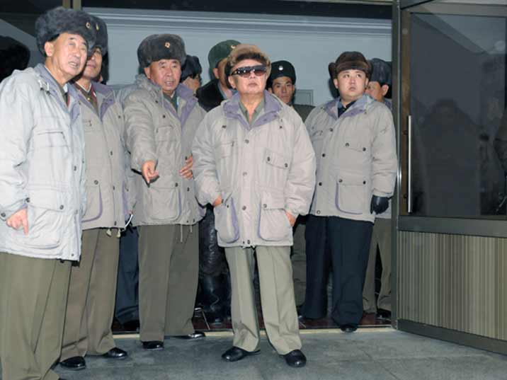 Kim Jong Il looking at a factory with his son Kim Jung Un