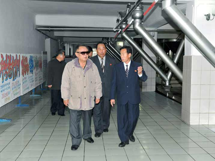 Kim Jong Il looking at a industrialized bakery