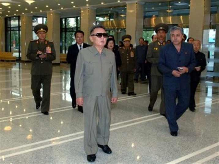 Kim Jong Il looking at a hallway where he just arrived