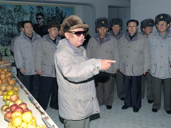 Kim Jong Il pointing at something while giving field guidance in Kwail County