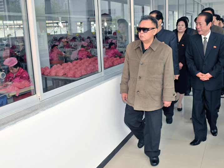 Kim Jong Il looking at seers during field Guidance to various Light Industry Factories