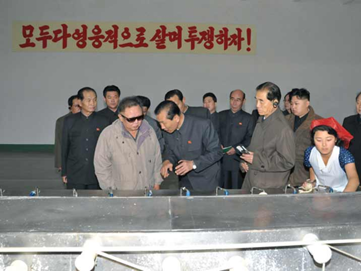 Kim Jong Il looking at treads during Field Guidance to Major Industrial Establishments in Hamhung