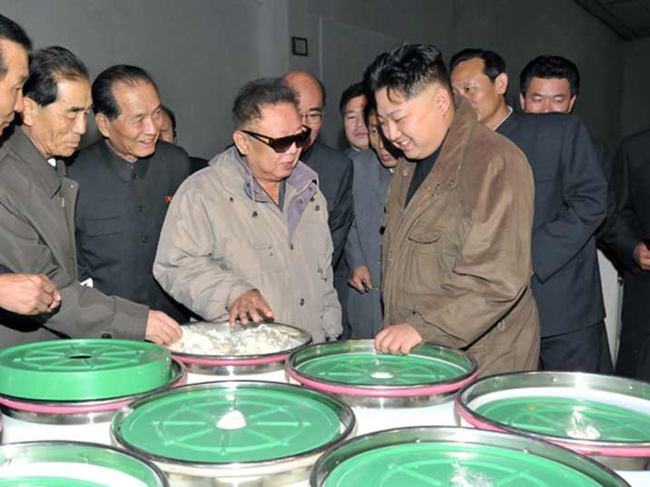 Kim Jong Il looking at cotton during Field Guidance to Major Industrial Establishments in Hamhung
