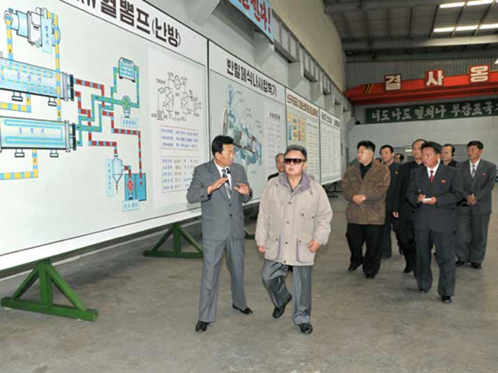 Kim Jong Il looking at plant diagram during Field Guidance to Major Industrial Establishments in Hamhung