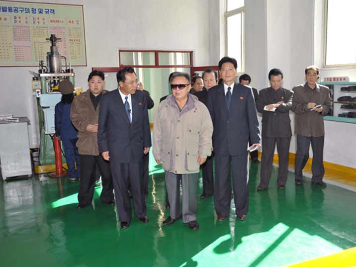 Kim Jong Il looking at a room belt during Field Guidance to Major Industrial Establishments in Hamhung