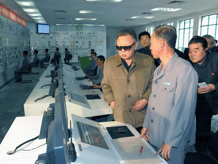 Kim Jong Il looking at the control room of a power plant
