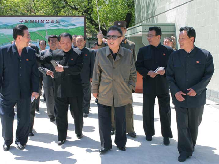Kim Jong Il looking at the outdoor part of a production complex