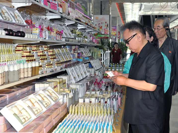 Kim Jong Il looking at perfume and skin products in a Pyongyang warehouse