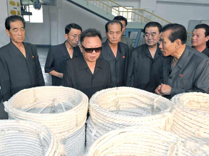 Kim Jong Il looking at ropes with the factory managers