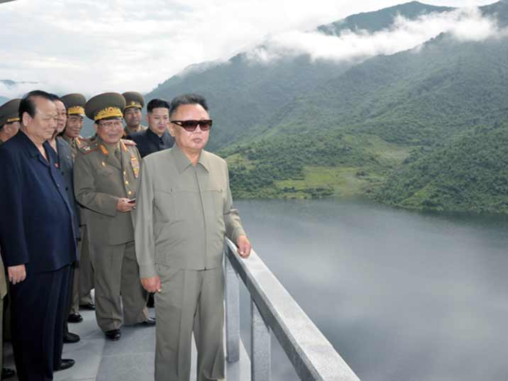 Kim Jong Il looking at a lake somewhere in the North Korean mountains