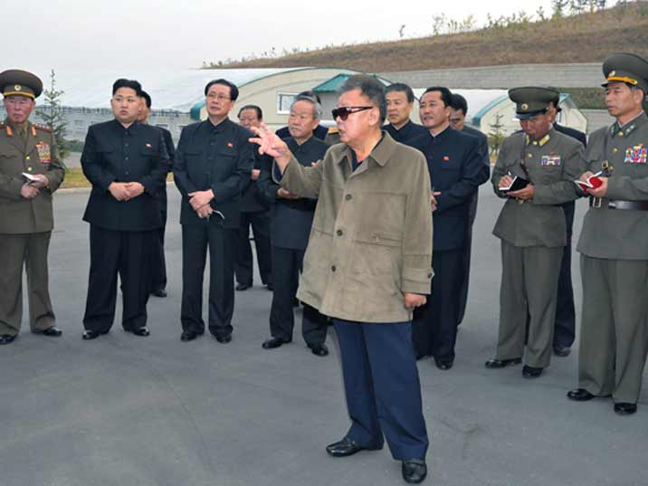Kim Jong Il looking at base of the Korean Peoples Army with his some and generals
