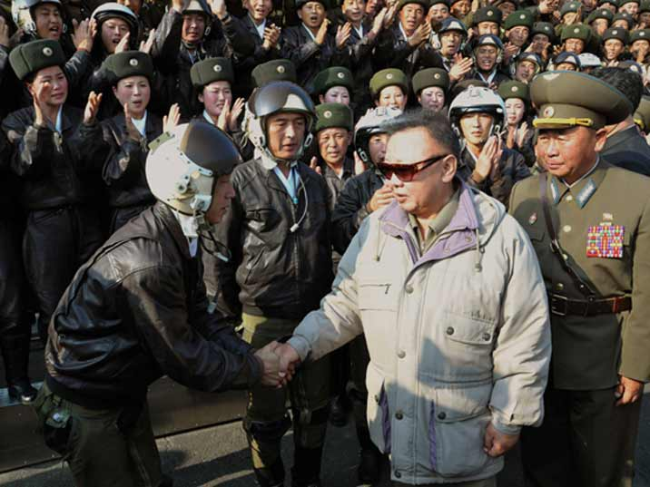 Kim Jong Il looking at a pilot during the visit of an KPA Air Force Base