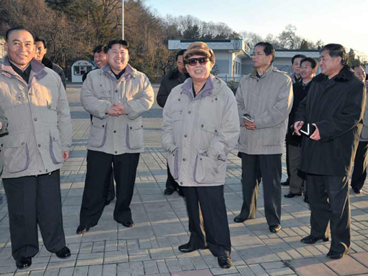 Kim Jong Il looking at something funny that makes him and everybody else laugh