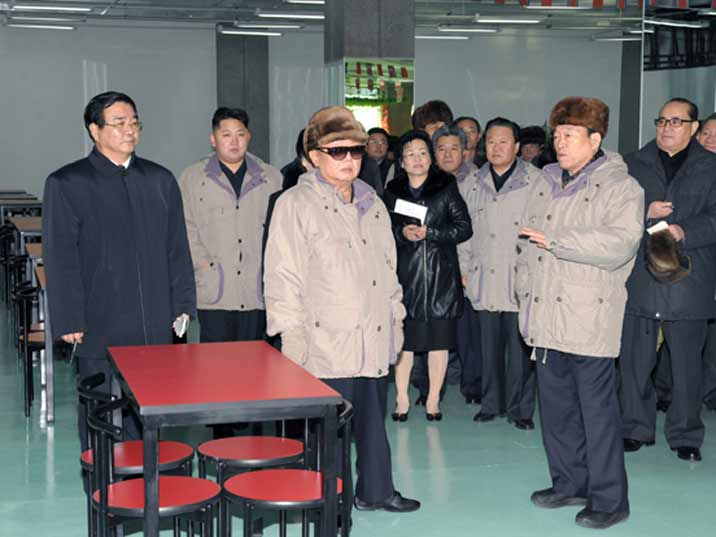 Kim Jong Il looking at restaurant in a factory where he is giving field guidance