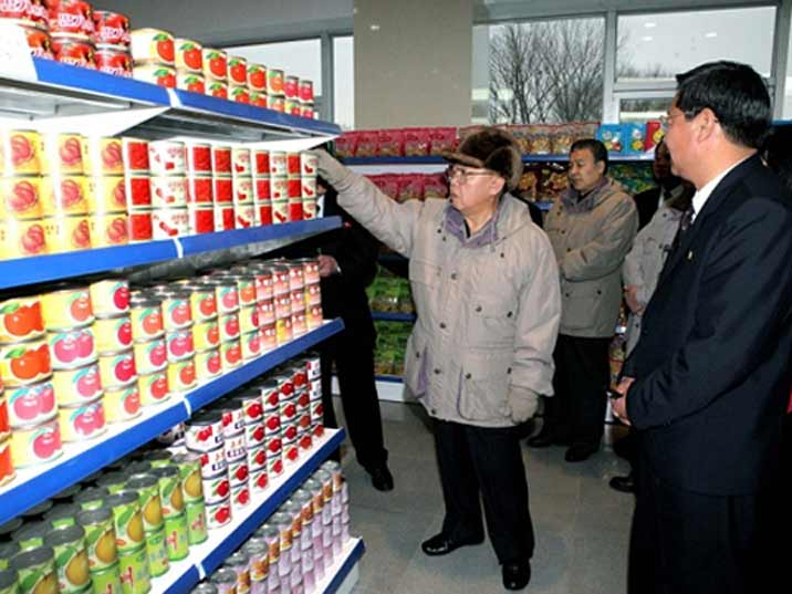 Kim Jong Il looking at canned food in a North Korean supermarket