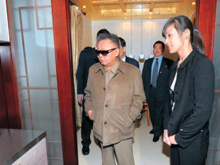 Kim Jong Il looking at a kitchen of a newly build apartment in Pyongyang