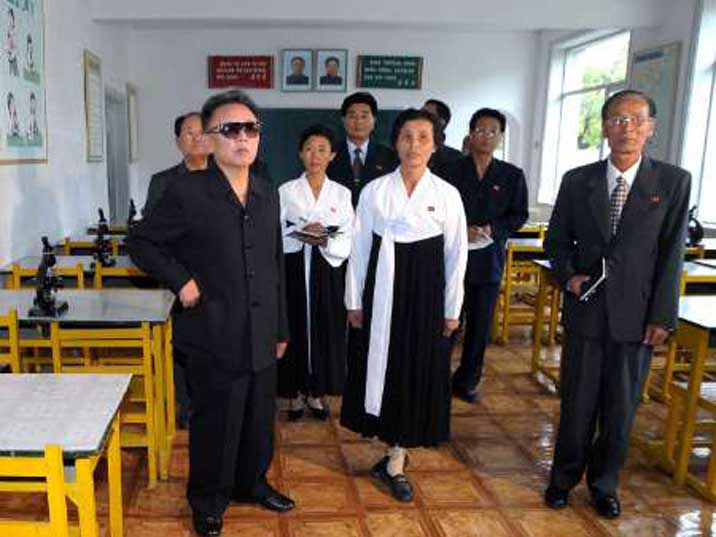 Kim Jong Il looking at a classroom with the school teachers