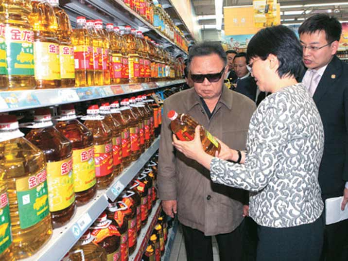 Kim Jong Il looking at cooking oil in s Pyongyang supermarket