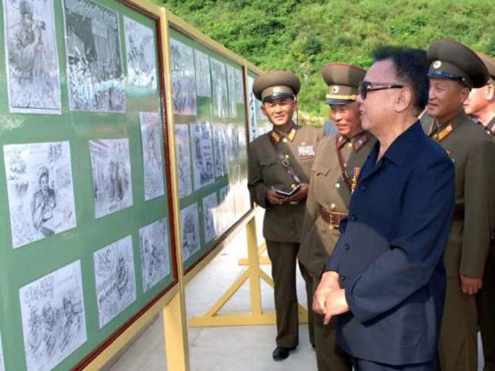 Kim Jong Il looking at drawings made by KPA soldiers during their duty for the fatherland