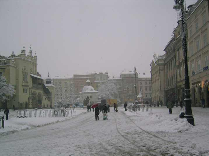 Visitors can by hot wine and bratwurst on the Main Market Square of Krakow that looks great in the winter