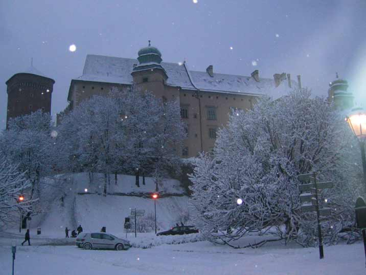 The impressive 14th century Wawel castle seen from the old town on a snowy winter day in Krakow