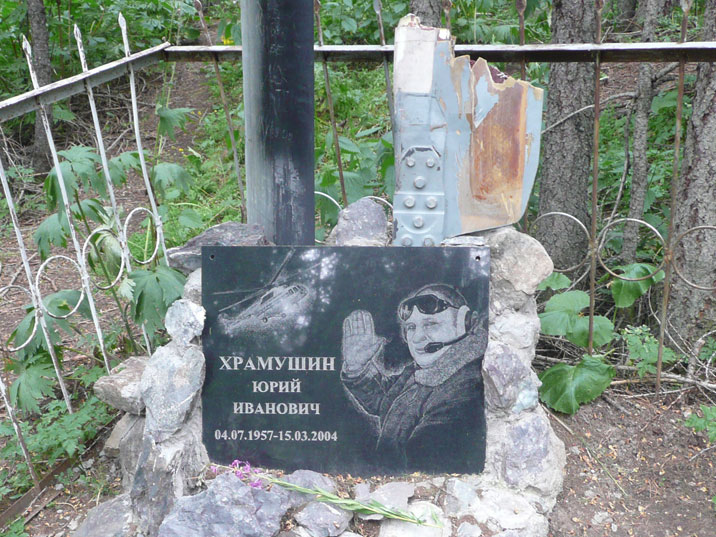 Grave of Yuriy Karmazin a local helicopter pilot who died during a helicopter crash in the Arpa Valley in 2004