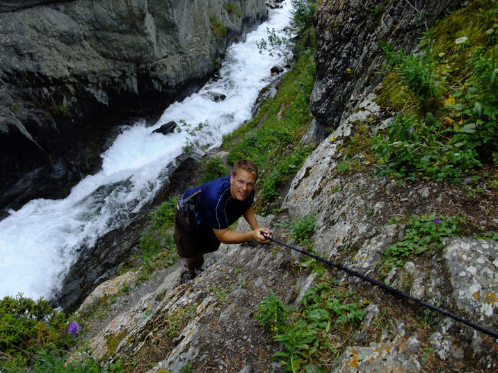 Climbing a steep mountain with a wild stream below in Ala Archa