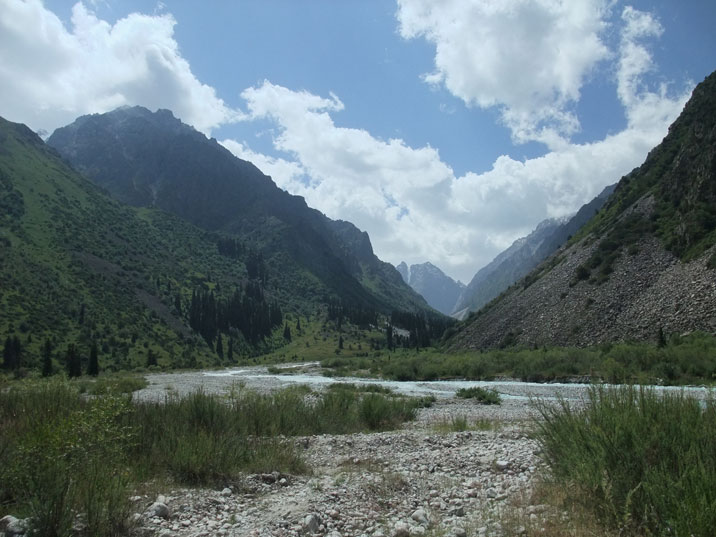 Peaks of the Tian Shan mountains of Ala Archa Park seen from valley of the Ale Archa River