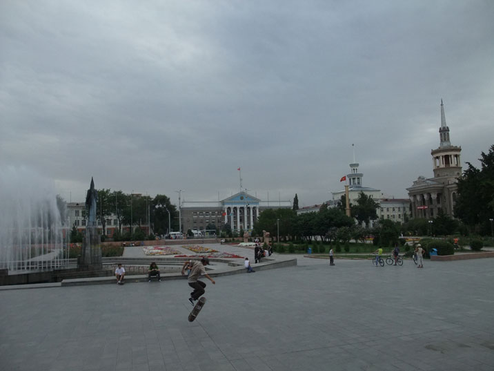 Kids playing on the square in front of the Philharmonic Hall near the Manas sculpture complex