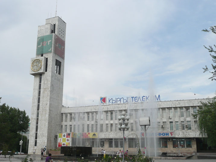 The Kyrgyz Telecom building constructed in 1979, with the most famous clock of the city on the tower