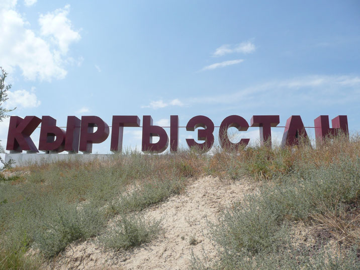 Welcome sign at the Kyrgyz Kazakh border crossing in Korday