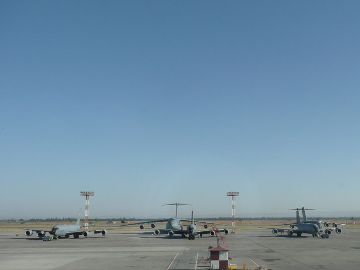 Five US Air force KC-135 Stratotankers, a C-17 Globemaste and a C-5 Galaxy seen from the passenger terminal of Manas airport