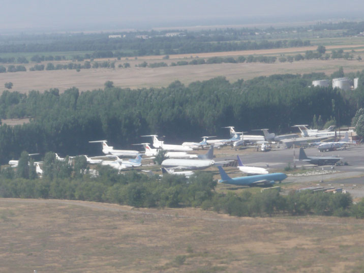 Airplane graveyard at Manas Airport with many disbanded Soviet aircraft including a series of Aeroflot Tu-134 aircraft