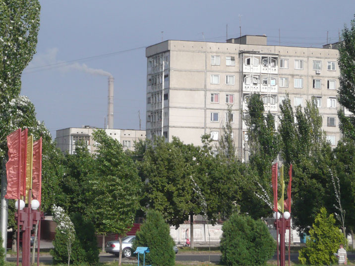 Residential buildings with the chimneys of the Bishkek Power Plant in the background