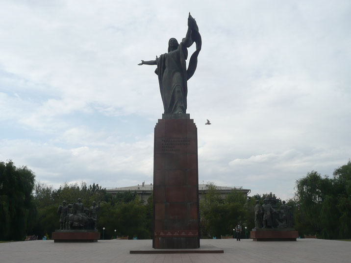 1978 monument depicting Kyrgyz social activist Urkuya Salieva, who points her flag to the martyrs of revolution who gave their lives for the revolution