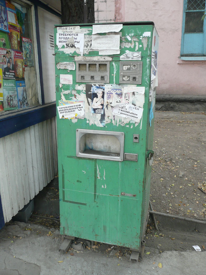 Typical Soviet era soda vending machine that is really beat up but still in use today