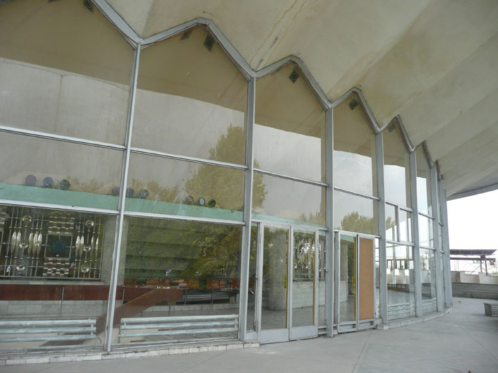 Exterior of the Bishkek circus that is constructed with typical 1970s Soviet building materials like steel, glass and marble