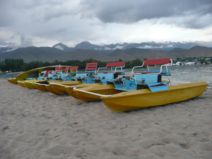 Colorful soviet era water bikes for rent in Lake Issyk Kul