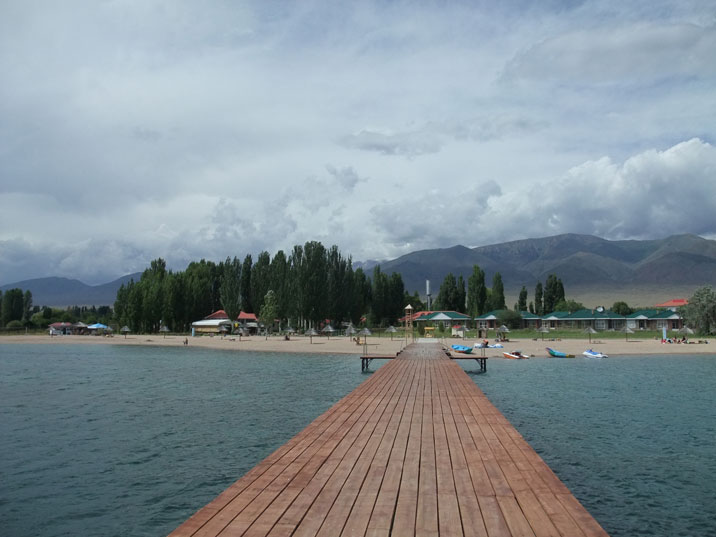 Lake Issyk Kul beach resort where tourists can have some relax time while traveling Central Asia